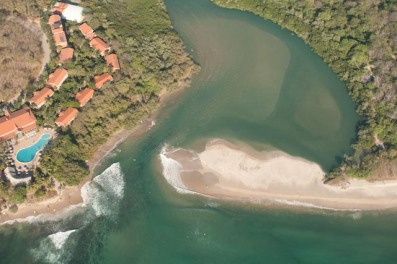 Juxtaposition of high levels of coastal development in Tamarindo, Costa Rica (L), where sea turtles no longer nest, and essentially pristine habitat on Playa Langosta (R), where leatherbacks continue to nest. Estero San Francisco--a RAMSAR site--separates the two.